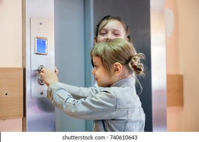 Two little sisters causing   lift in medical  clinic