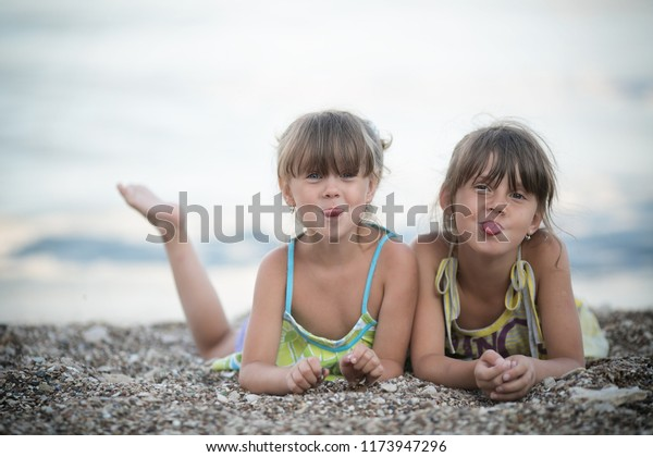Two little sisters on the beach