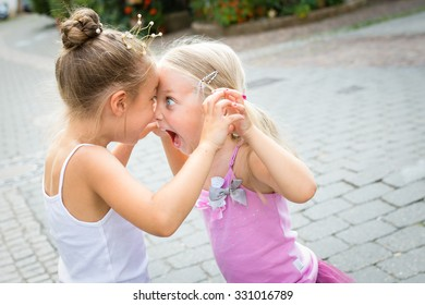 two little sisters quarreling and playing, selective focus.
