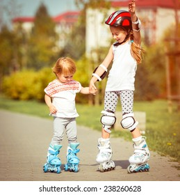 two little sisters to roller skate on the street