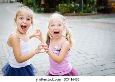 Two little sisters shouting. Selective focus.