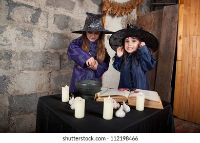 two little witches conjure in an abandoned house