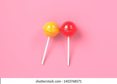 two lolipop red and yellow on pink pastel background. Sweet candy concept