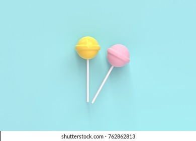 two lolipop yellow and pink on mint blue pastel background.sweet candy concept
