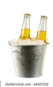 Two long neck bottles of beer in a bucket with ice isolated on white