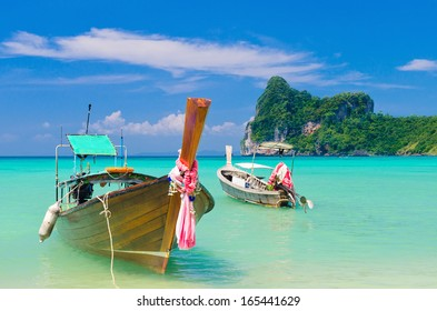 Two longtail boat at Loh Dalum beach, Thailand