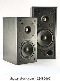 Two loud speakers of different size, isolated on white background.