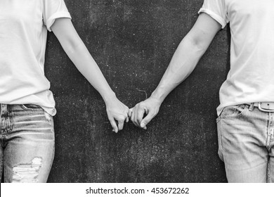 Two love couples hold hand together in black and white photo.