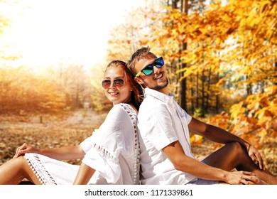 Two lovers in forest and autumn time