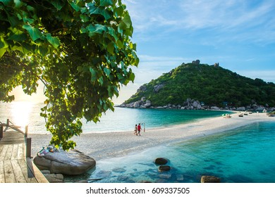 Two lovers hold their hand walking to the beach during sunset, Koh Nangyaun small island near Koh Tao, Koh Samui and Koh Phangan