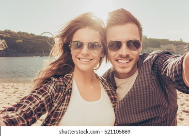 Two lovers making a selfie photo near the river, close-up phot