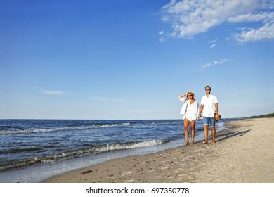 two lovers on summer beach and blue sky landscape with ocean