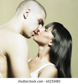 Two lovers. Photo of passionate couple. Man kissing woman