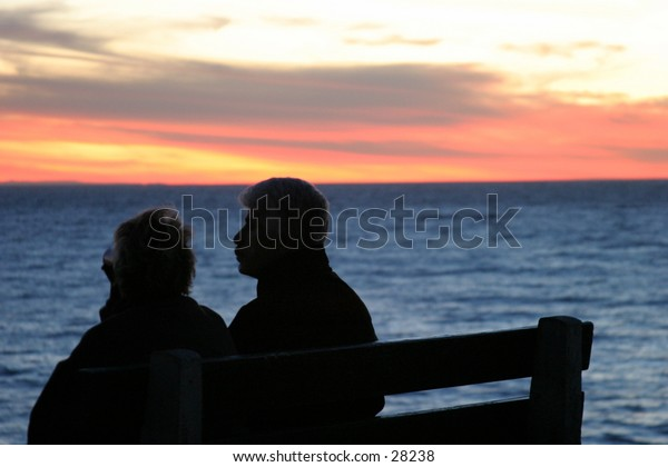 two loves sit and watch the sunset in laguna beach california the evening before a major storm rolled in