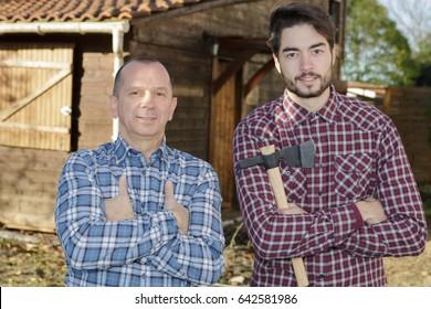 two lumberjacks outside building