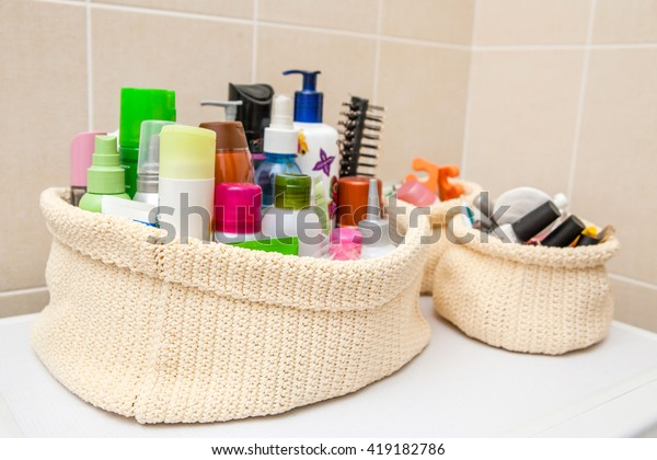 two make up bag with cosmetics and brushes