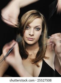 Two Makeup artist  help girl getting her makeup