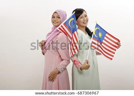 b04844421fbd Two Malay Women Holding Malaysia Flag Stock Photo (Edit Now ...