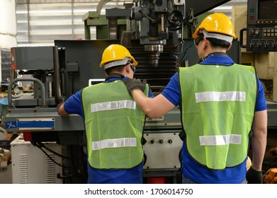 Two Male asian inspector, engineer consoling in the production line process in factory
