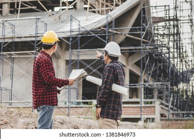 Two male engineer looking commercial building structure