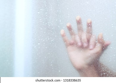two male and female Couple lovers holding hands having sex inside showers bathroom mirror with a steamy window. soft focus.  Leave copy space empty to write text on the side.