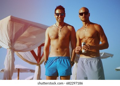 Two Male Friends at the Beach. Happy Relaxed Friends Seaside