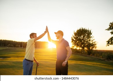 Two male friends playing golf together