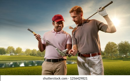 Two male golf players on professional golf course. Smiling golfers with golf clubs