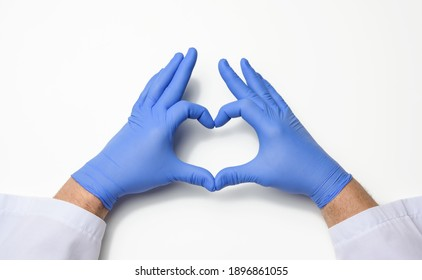 two male hands in blue latex sterile medical gloves shows a gesture of the heart on a white background, concept of goodness, help and volunteering