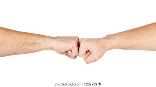 Two male hands as fists together isolated on white