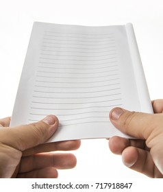 two male hands holding empty white blank paper with horizontal lines. isolated o white background. back to school idea, sign, symbol. empty frame background