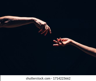 Two male hands reaching out to one another, almost touching, in front of dark clear empty background wall concept. Hands concept. Love photo. Sensual. Hand. Help me. Lovers. Romance. Energy. Life.