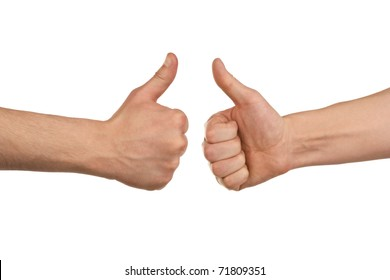 Two male hands showing thumbs up sign against white background