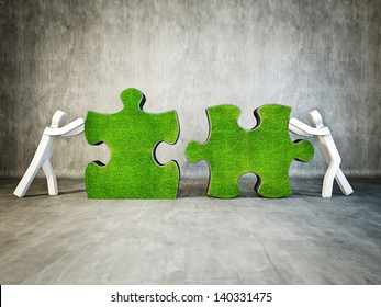 two man building puzzle on concrete background