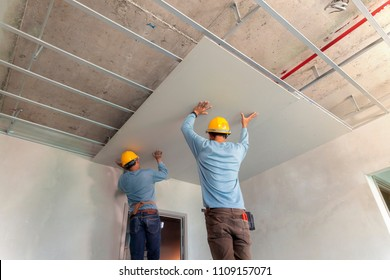 Two man help for ceiling house construction