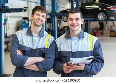Two man mechanics working