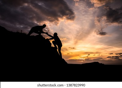 two man in mountain at the color sunset