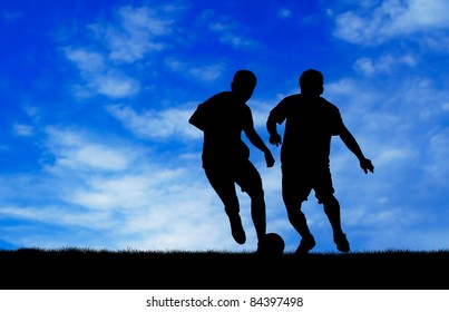 two man soccer player playing with ball at day time silhouetted