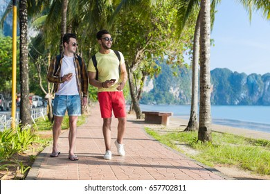 Two Man Using Cell Smart Phones Tropical Park Couple Chatting Online Holiday Sea Summer Vacation Ocean Travel