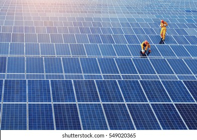 Two man working at solar power station