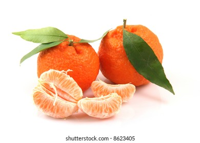 two mandarins with leaf and slices isolated on white background fruits and agriculture concepts