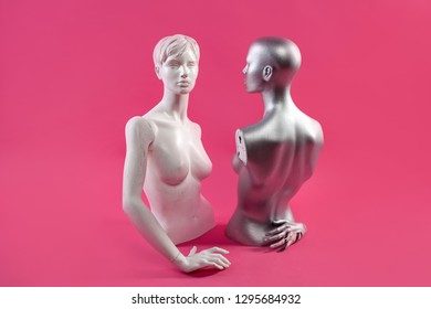 Two mannequins on a pink background. Fashion and design concept.
