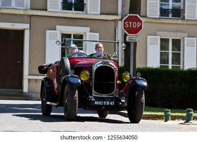 two mans on the old classic car in racer's parade festival 24hours Le mans -Le Mans city France 2016