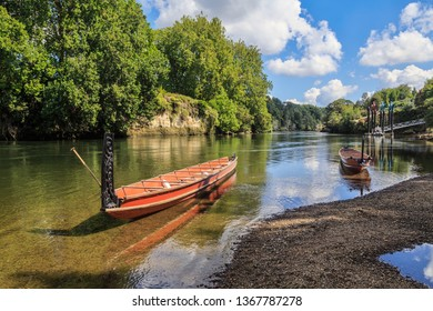 Two Maori Waka (Canoes) With Carved Prows on the Waikato River, New Zealand
