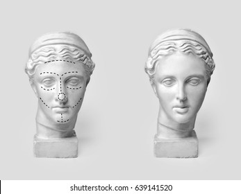 Two marble heads of young women, ancient Greek goddess bust marked with lines for plastic surgery and sculpture after operation on light background. Old and new beauty standarts concept.