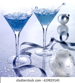 two martini glasses filled with clear blue alcoholcrushed ice and swizzle stickssilver - Christmas Martini Glasses