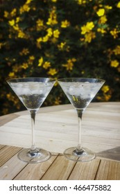 Two martini glasses in the sunshine