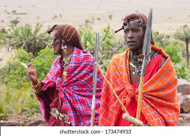 Two Masai warriors standing and looking away