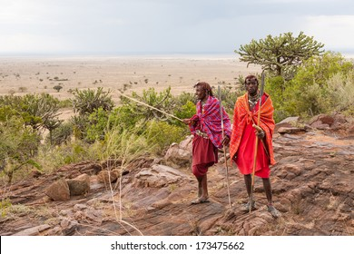 Two Masai warriors standing and looking away, soft focus