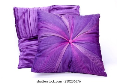 two mauve scatter cushions with intricate decorative patterns